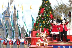 """LAKE BUENA VISTA, FL - DECEMBER 01:  In this handout photo provided by Disney, Mickey and Minnie Mouse wave to the crowd while taping the """"Disney Parks Christmas Day Parade"""" TV special in the Magic Kingdom park at Walt Disney World on December 1,2012 in Lake Buena Vista, Florida.  The annual parade telecast, which airs Dec. 25, 2012 at various times across the country on ABC-TV, features celebrity performances and segments taped at Walt Disney World in Florida and Disneyland Resort in California.  Featured performers include Lady Antebellum, Backstreet Boys, Brad Paisley, Phillip Phillips, Colbie Caillat, TobyMac, Yolanda Adams, Ross Lynch, the cast of """"Newsies"""" and a U.S. Marine Corps Band. (Photo by Mark Ashman/ Disney via Getty Images)"""