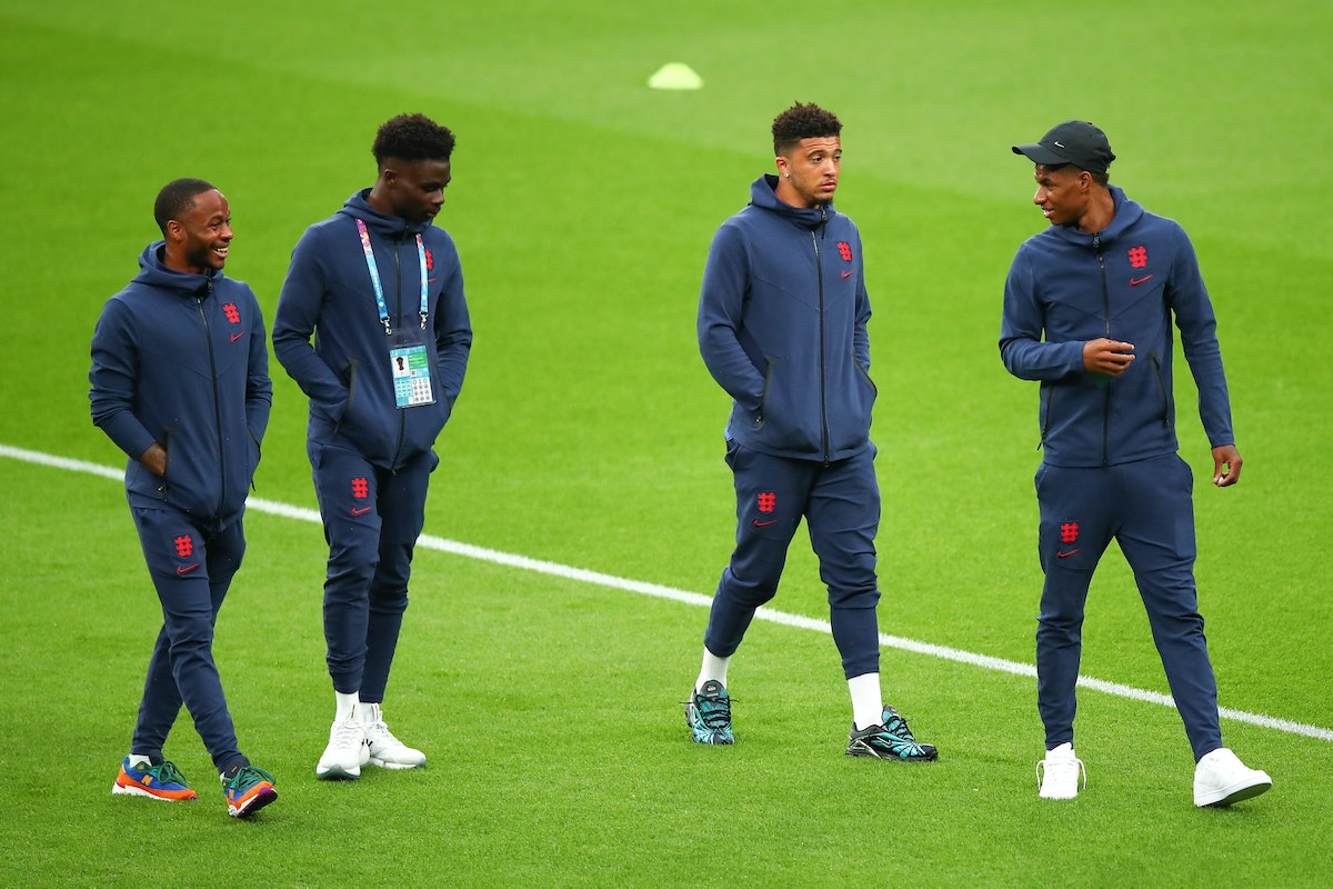 England footballers Raheem Sterling, Marcus Rashford, Jadon Sancho and Bukayo Saka, are pictured here on the soccer field, and three of these men are facing racist abuse after their team's loss.