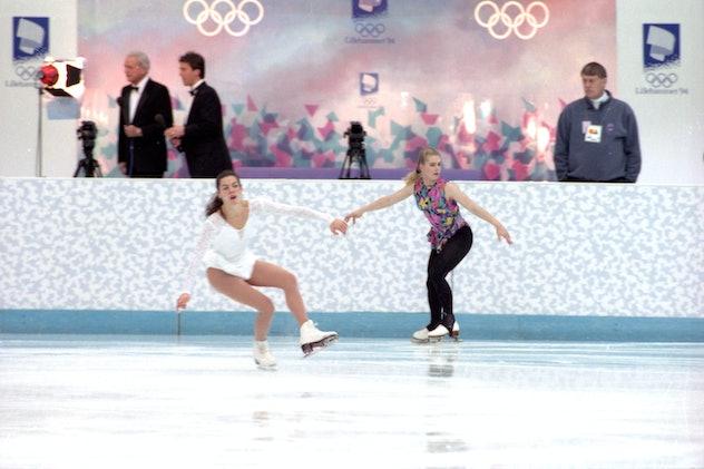 HAMAR - FEBRUARY 17: U.S.A. figure skaters Nancy Kerrigan, left, and Tonya Harding skate past one an...