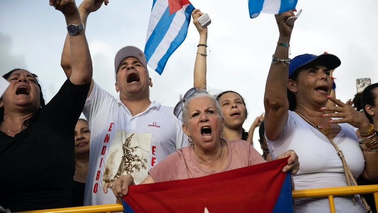 MIAMI, FLORIDA - JULY 14:  Protesters gather in front of the Versailles restaurant in the Little Havana neighborhood to show their support for the people in Cuba that have taken to the streets to protest on July 14, 2021 in Miami, Florida. On Sunday, thousands of Cubans took to the streets across the country to protest pandemic restrictions, the pace of Covid-19 vaccinations and the Cuban government. (Photo by Joe Raedle/Getty Images)