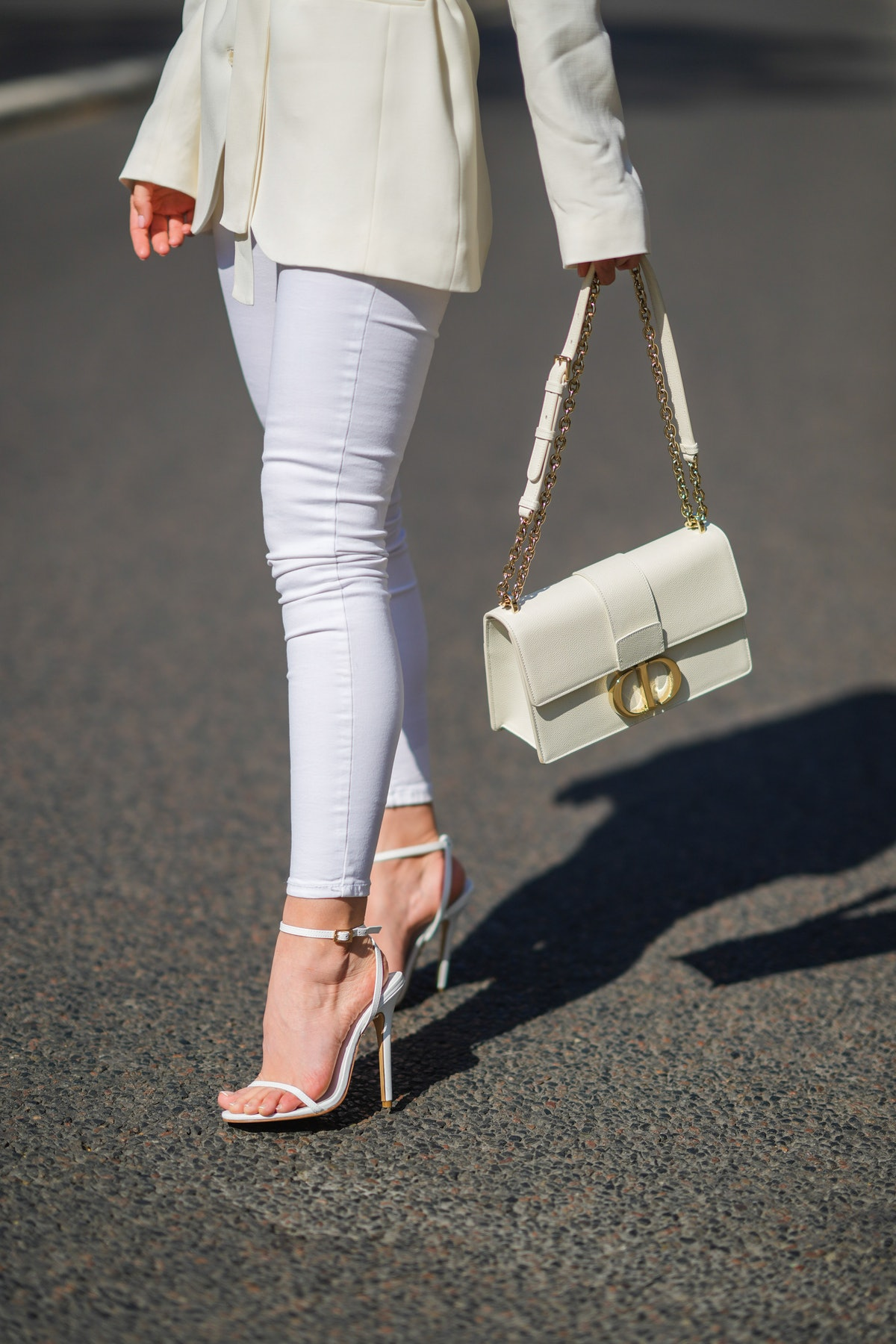 A person wearing white, skinny jeans.