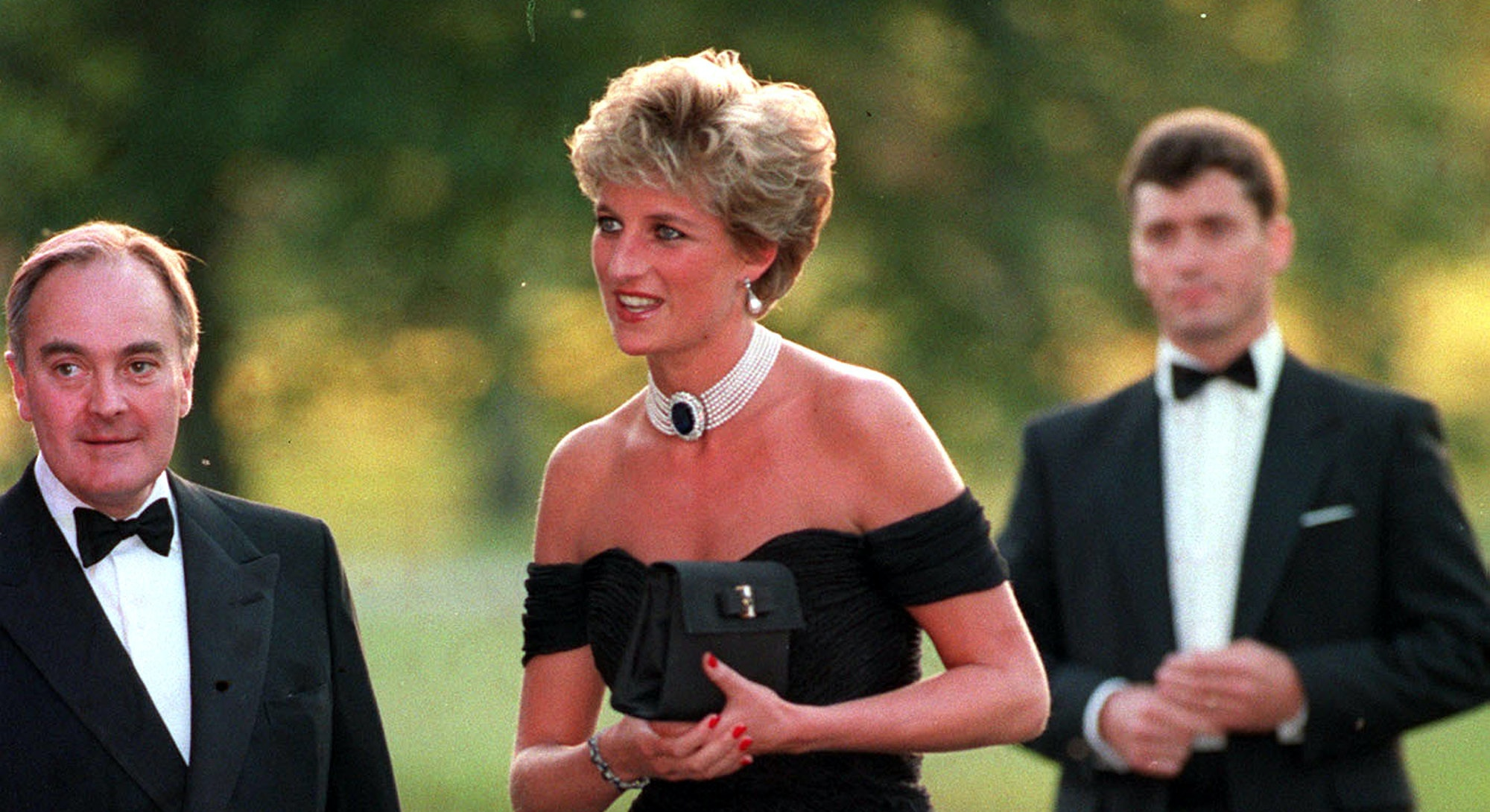 """Princess Diana wearing the """"revenge dress"""" as she arrives at the Serpentine Gallery"""