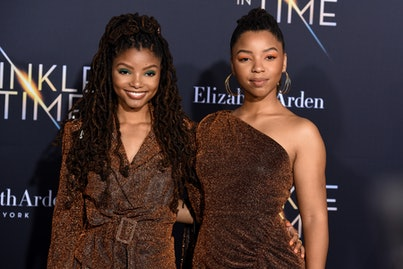 """LOS ANGELES, CA - FEBRUARY 26:  Halle Bailey and Chloe Bailey attend Premiere Of Disney's """"A Wrinkle..."""