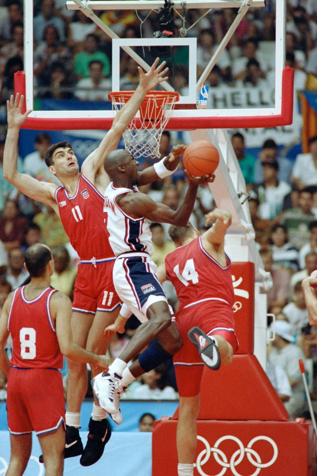 American basketball star Michael Jordan smashes during the final of the 1992 Barcelona Olympic baske...