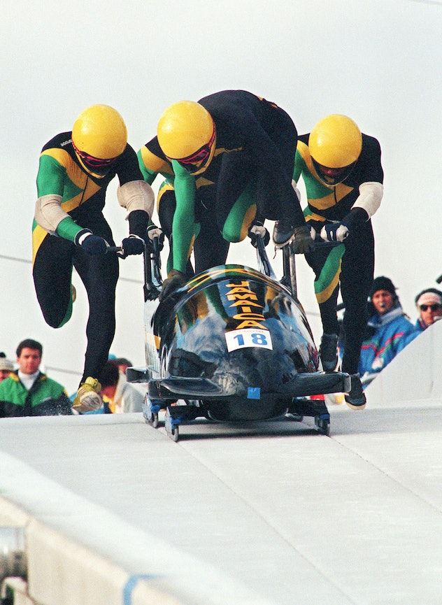 Jamaican four-man bobsleigh pilot Dudley Stokes jumps in as his three teammates push off at the star...