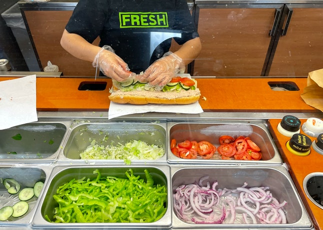 SAN ANSELMO, CALIFORNIA - JUNE 22: A worker at a Subway sandwich shop makes a tuna sandwich on June ...