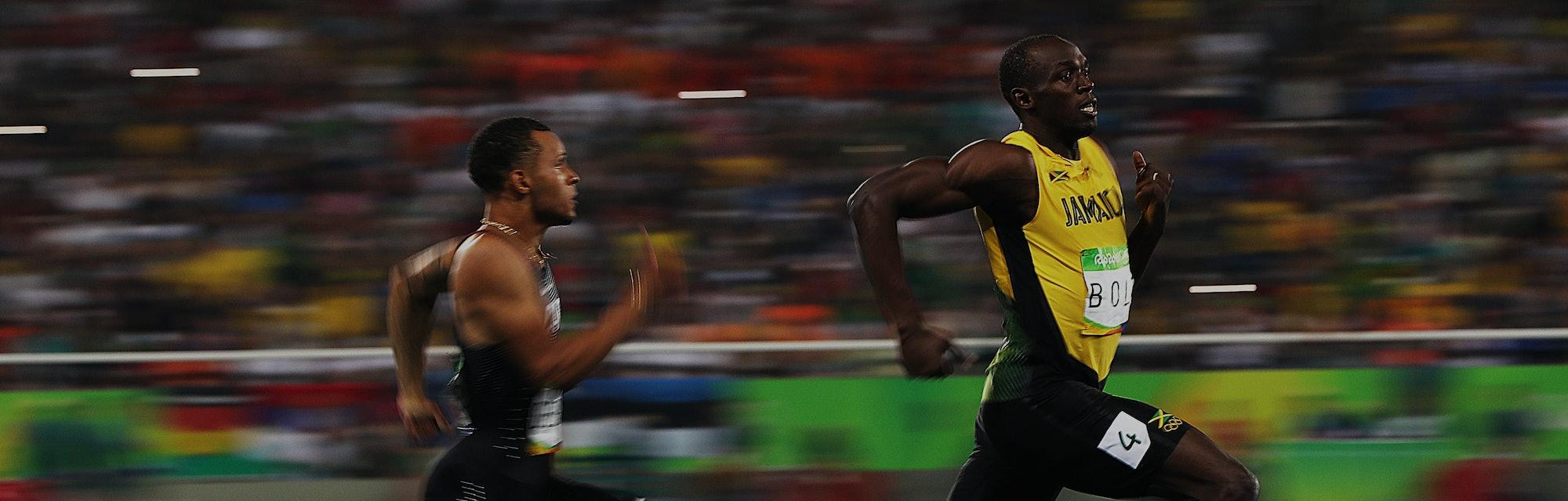 RIO DE JANEIRO, BRAZIL - AUGUST 17: Andre de Grasse of Canada and Usain Bolt of Jamaica react as the...