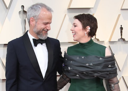 HOLLYWOOD, CA - FEBRUARY 24: Ed Sinclair and Olivia Colman attend the 91st Annual Academy Awards at ...