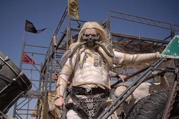 """A man in a """"Mad Max"""" Immortan Joe costume poses for pictures during Wasteland Weekend festival at th..."""