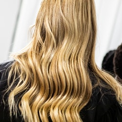 MILAN, ITALY - SEPTEMBER 27: A model, hair detail,  is seen backstage at the Shi.Rt fashion show during the Milan Women's Fashion Week on September 27, 2020 in Milan, Italy. (Photo by Rosdiana Ciaravolo/Getty Images)