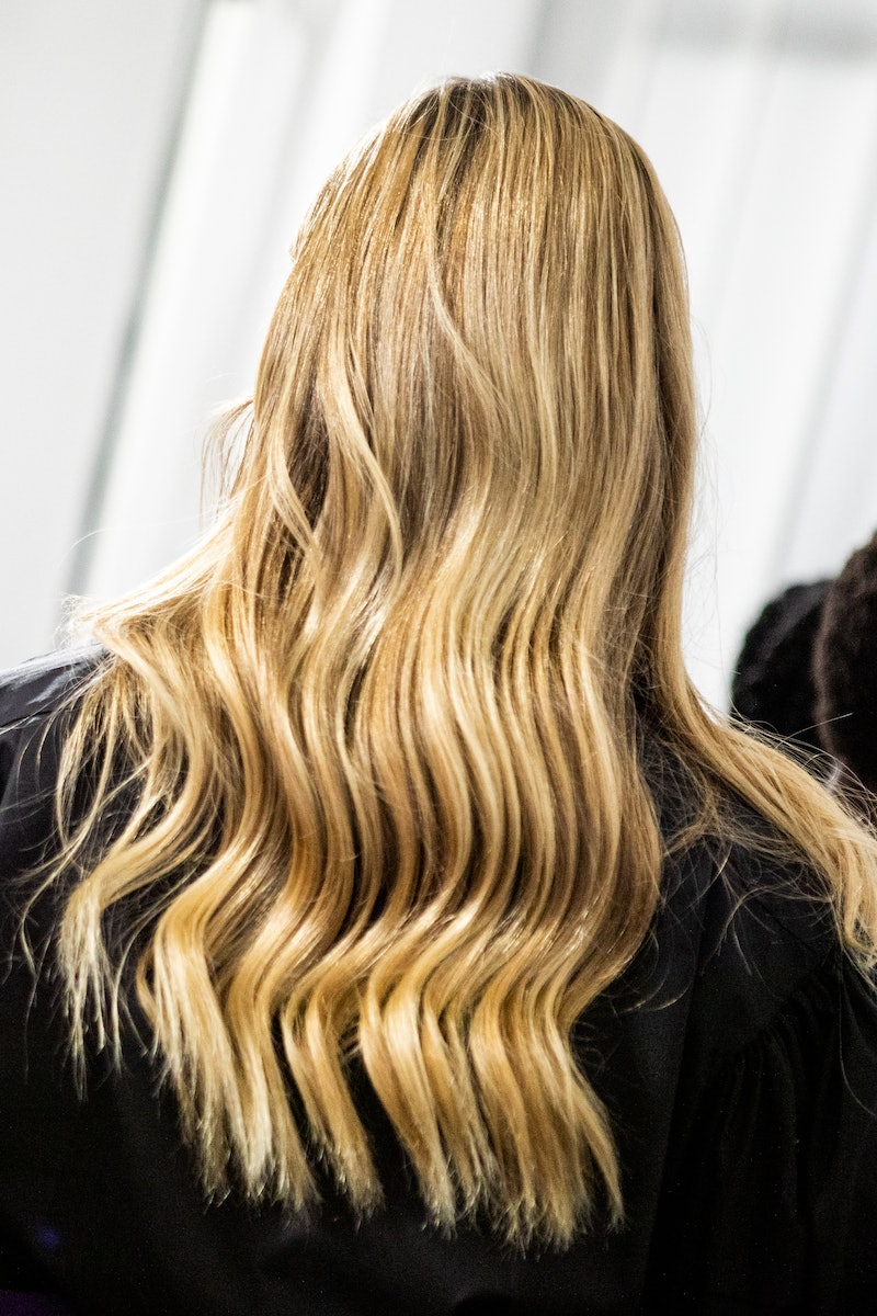 MILAN, ITALY - SEPTEMBER 27: A model, hair detail,  is seen backstage at the Shi.Rt fashion show dur...