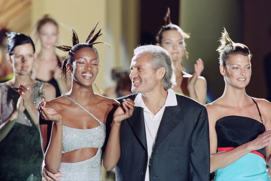 Italian fashio, designer Gianni Versace, with models, British Naomi Campbell and Canadian Linda Evan...