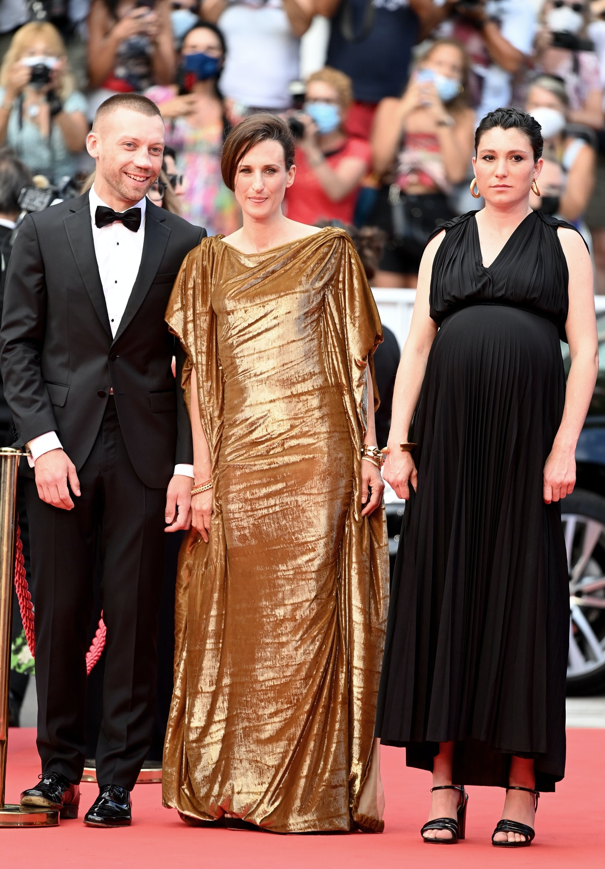 """CANNES, FRANCE - JULY 15: Aleksandr Kuznetsov, Camille Cottin and Rachel Lang attend the """"France"""" screening during the 74th annual Cannes Film Festival on July 15, 2021 in Cannes, France. (Photo by Kate Green/Getty Images)"""