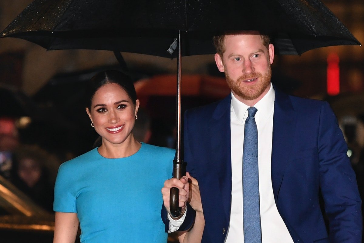 Britain's Prince Harry, Duke of Sussex (R) and Meghan, Duchess of Sussex arrive to attend the Endeav...