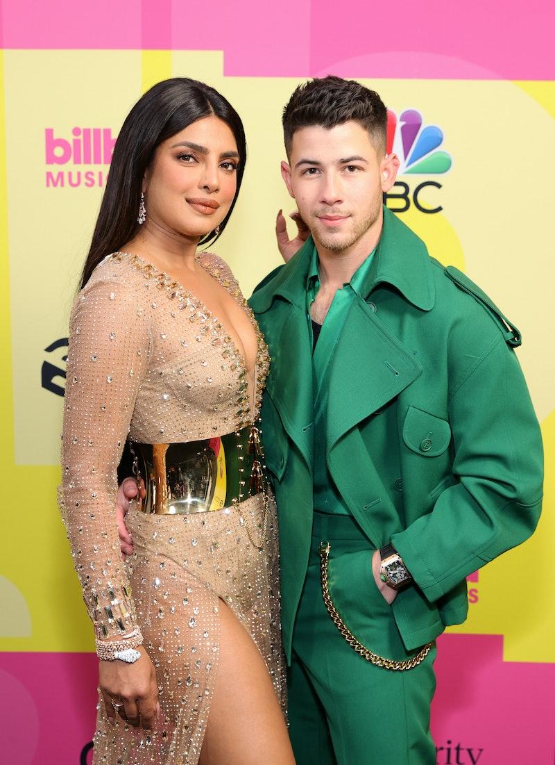LOS ANGELES, CALIFORNIA - MAY 23: (L-R) Priyanka Chopra Jonas and Nick Jonas pose backstage for the ...