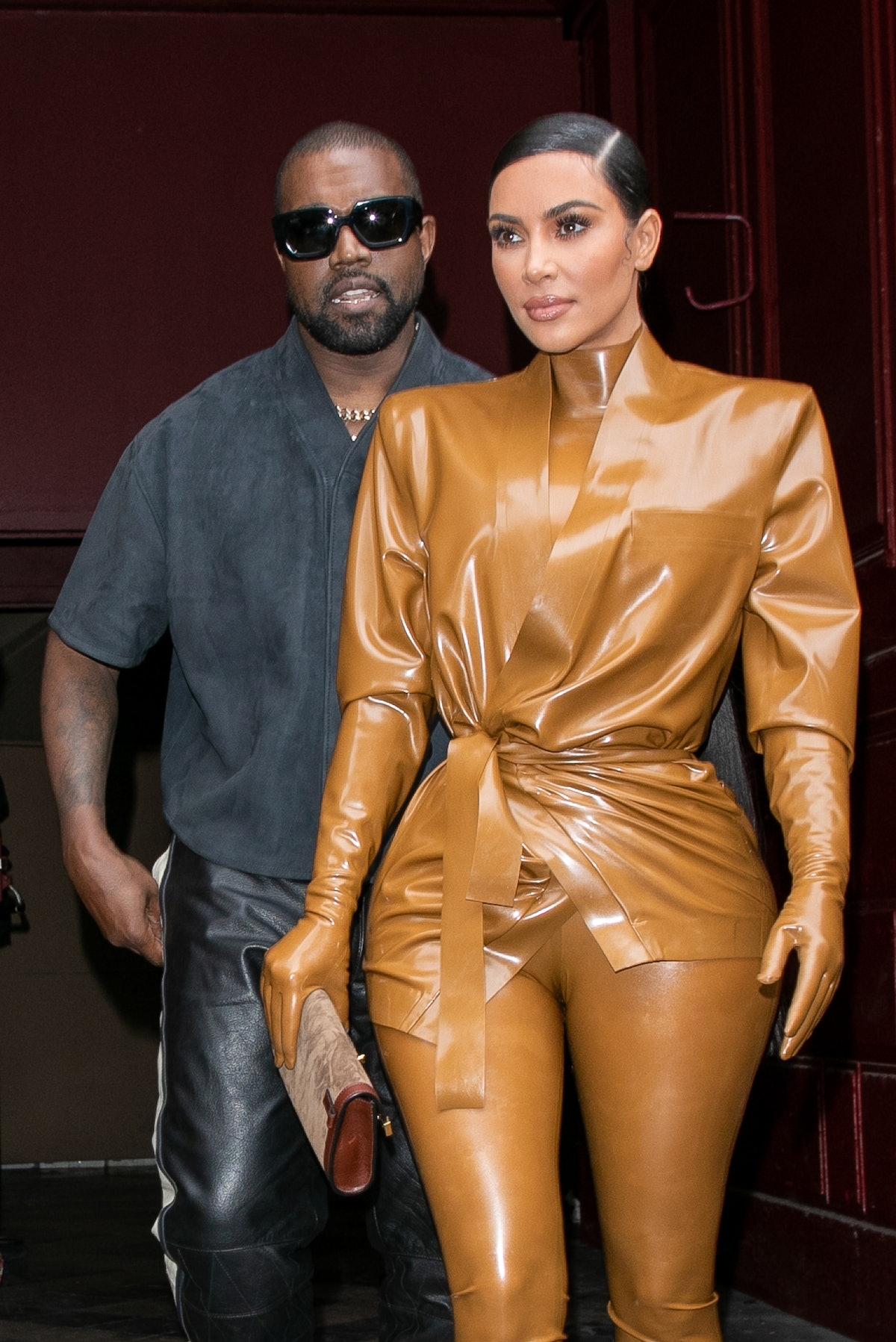 PARIS, FRANCE - MARCH 01: Kim Kardashian West and husband Kanye West leave K.West's Sunday Service A...