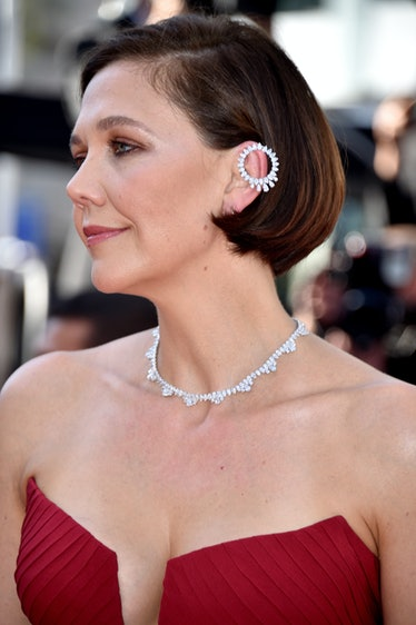 """CANNES, FRANCE - JULY 09: Actress Maggie Gyllenhaal attends the """"Benedetta"""" screening during the 74t..."""