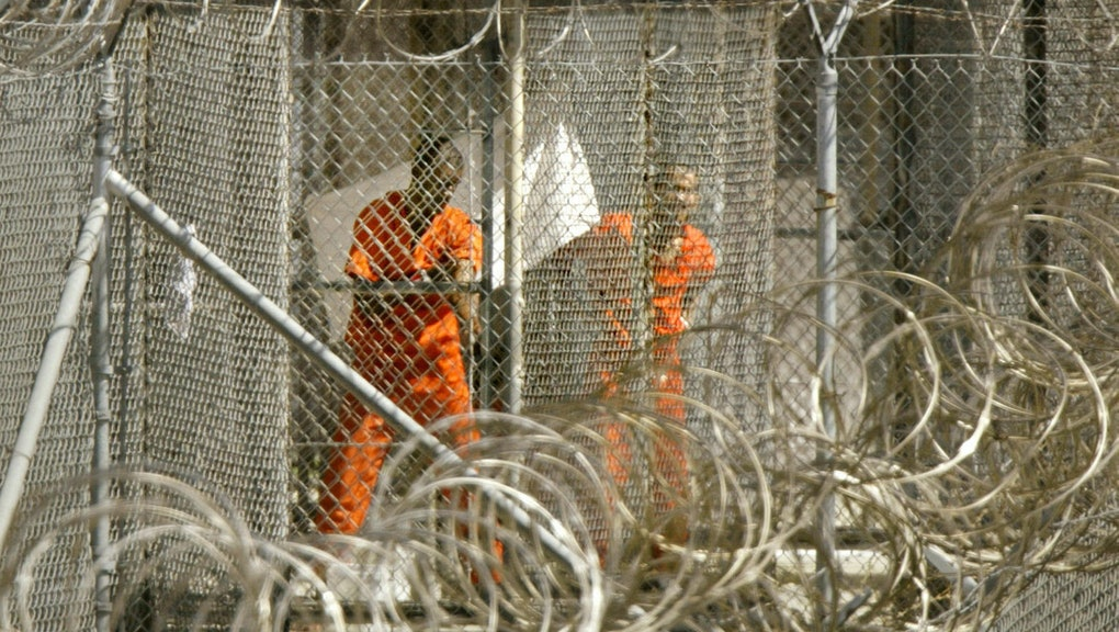 FILES - A picture taken on January 27, 2002 shows a detainee from Afghanistan wiping himself down as...