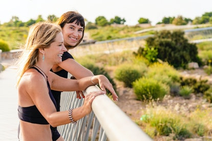 Two women talk while on a run. Experts share how to reconnect with someone.