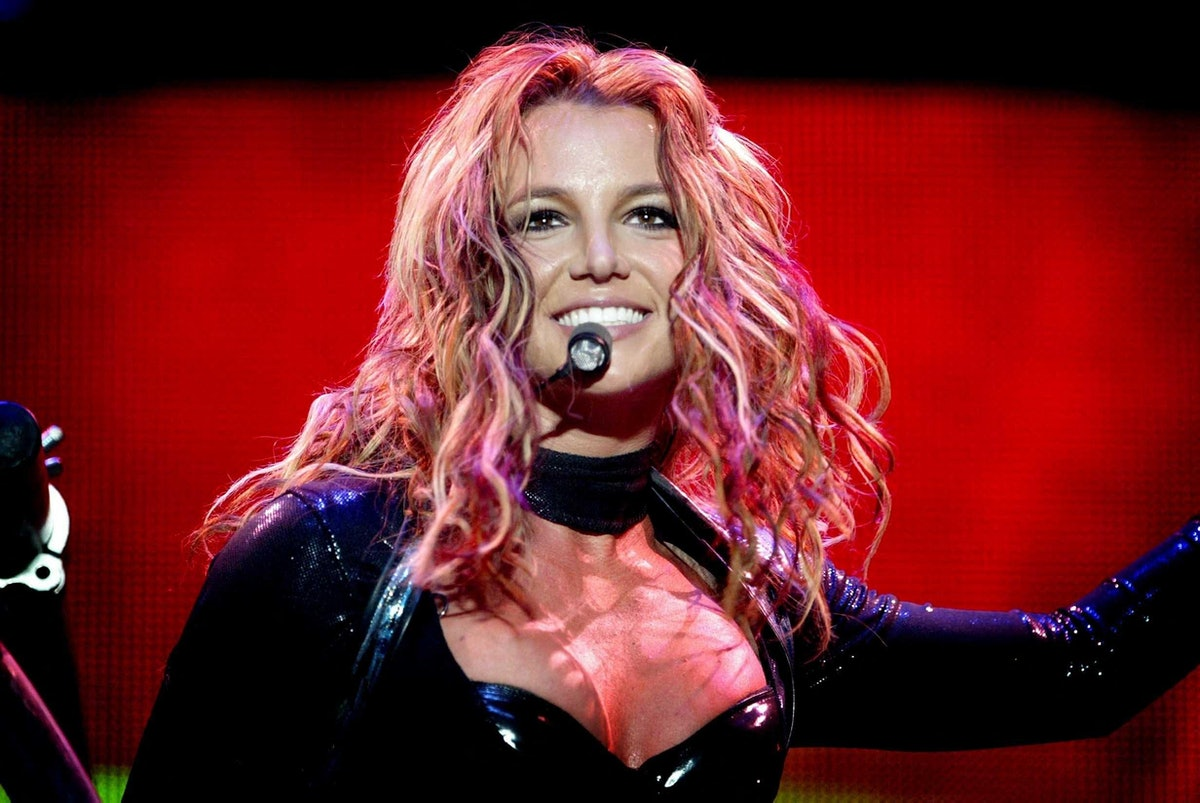 Britney Spears performing on stage and singing lyrics with confidence, using empowering quotes for I...