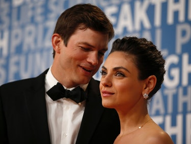 Actor Mila Kunis poses for a picture with her husband actress Ashton Kutcher on the red carpet for the 6th annual 2018 Breakthrough Prizes at Moffett Federal Airfield, Hangar One in Mountain View, Calif., on Sunday, Dec. 3, 2017. (Nhat V. Meyer/Bay Area News Group) (Photo by MediaNews Group/Bay Area News via Getty Images)