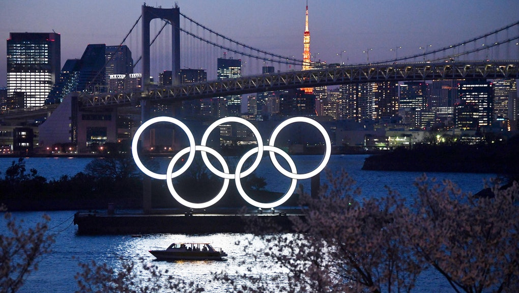 TOKYO, JAPAN - MARCH 25: A boat sails past the Tokyo 2020 Olympic Rings on March 25, 2020 in Tokyo, ...