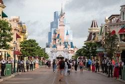 Visitors walk around Disneyland Paris parks following its reopening on June 17, 2021 in Paris, Franc...