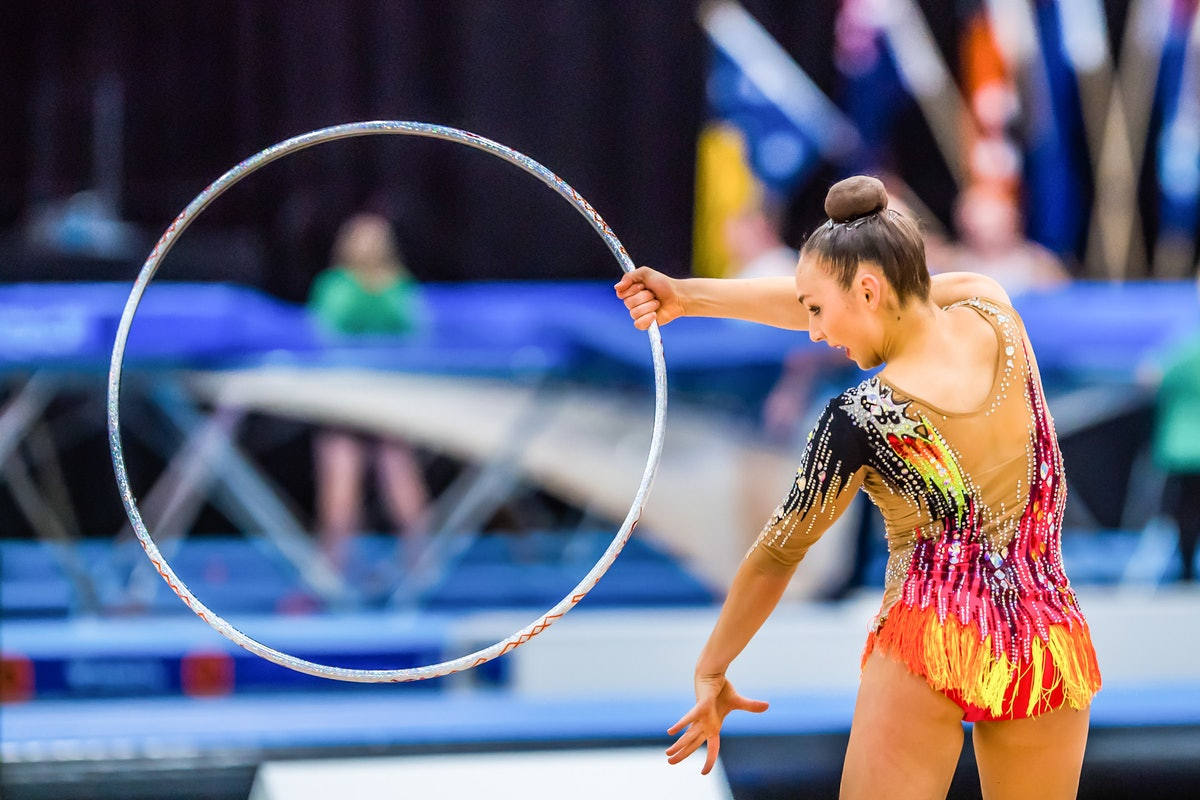 GOLD COAST, QUEENSLAND, AUSTRALIA - 2021/05/13: Australian Senior International Rhythmic Gymnast Alisa Gimgina performs during hoop routine at the Australian Gymnastics Championship 2021. (Photo by Alexander Bogatyrev/SOPA Images/LightRocket via Getty Images)