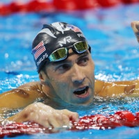 Michael Phelps of the USA celebrates after winning the Gold medal at the Men's 200m Butterfly Final ...