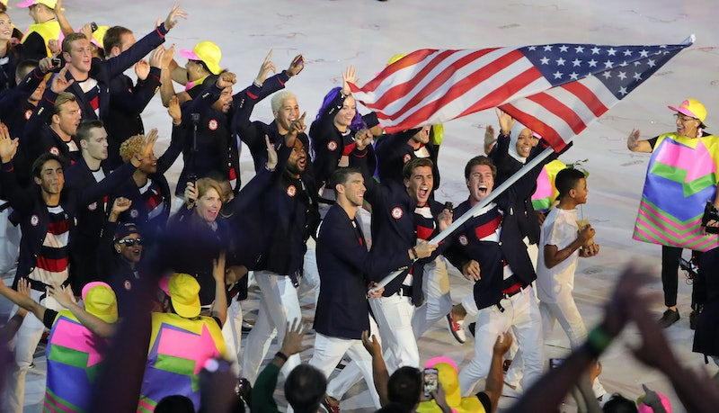 Michael Phelps carries the flag for Team USA during Parade of Nations in 2016.