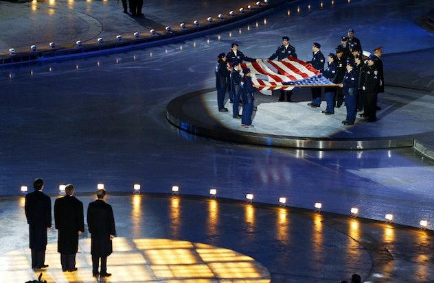 SALT LAKE CITY, UT - FEBRUARY 9:  US President George W. Bush (C), OIC President Jacques Rogge (R) a...