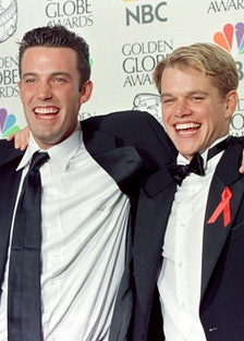 Actor Matt Damon (R) and co-writer Ben Affleck (L)  pose with their Golden Globe award for Best Scre...