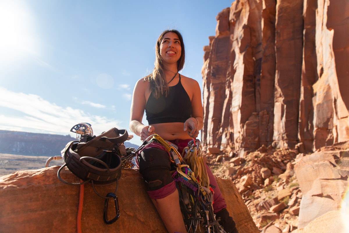 Young woman about to climb mountain, showing she'd be a sport climber if she competed in the Olympic...