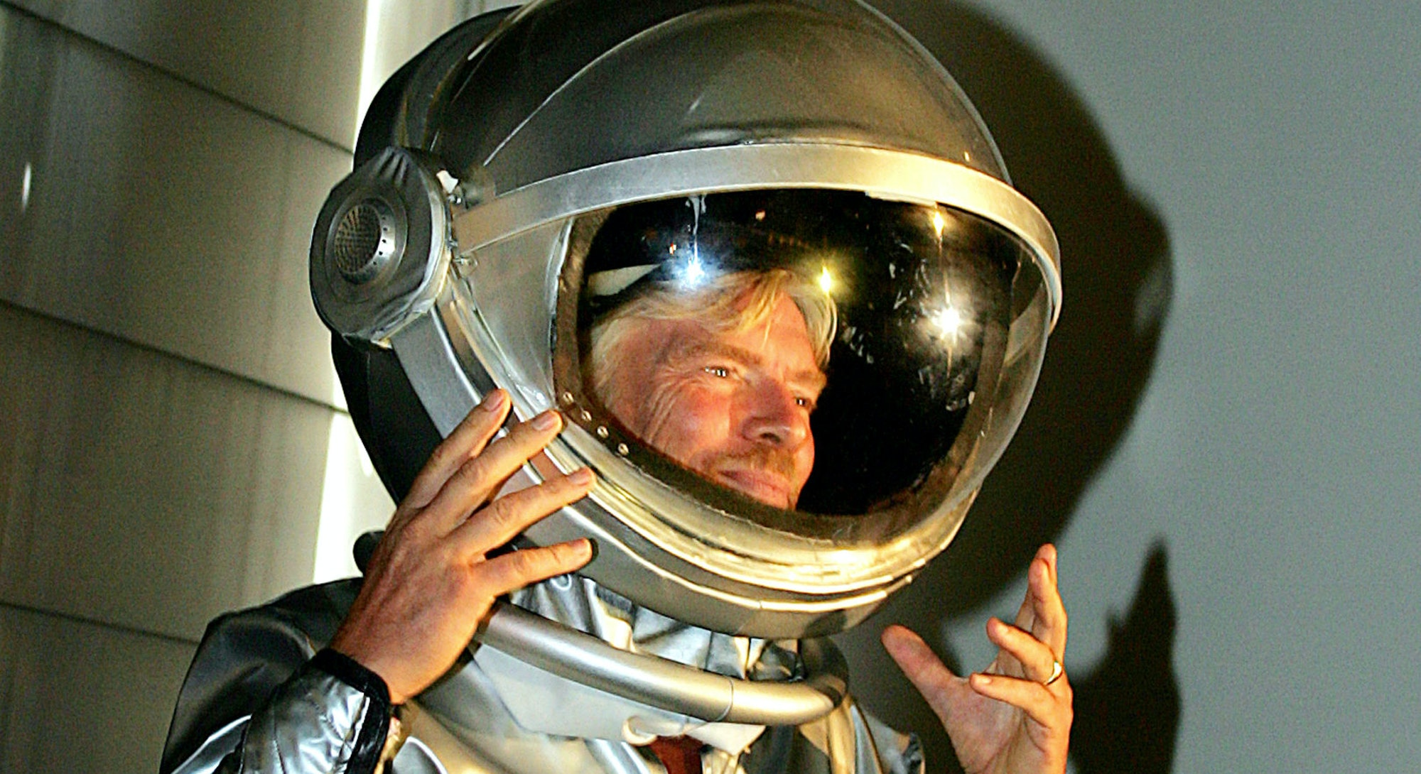 Richard Branson arrives in a space suit for the announcement in Sydney, 13 December 2005, of Austral...