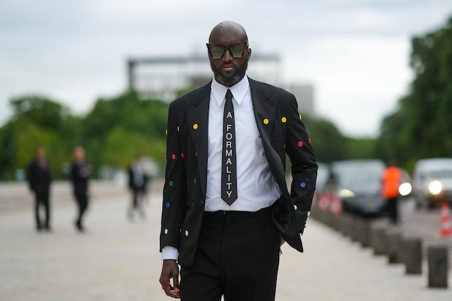 PARIS, FRANCE - JULY 05: Virgil Abloh wears a white shirt, a black tie with 'A Formality' slogan, a ...