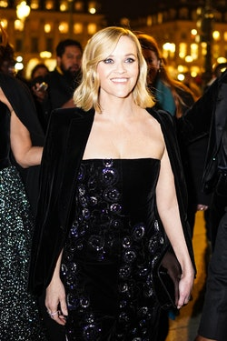 PARIS, FRANCE - JANUARY 21: Reese Witherspoon wears an off-shoulder dress and a black velvet jacket,...