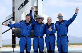 VAN HORN, TEXAS - JULY 20: Blue Origin's New Shepard crew (L-R) Oliver Daemen, Jeff Bezos, Wally Funk, and Mark Bezos pose for a picture near the booster after flying into space in the Blue Origin New Shepard rocket on July 20, 2021 in Van Horn, Texas. Mr. Bezos and the crew were the first human spaceflight for the company. (Photo by Joe Raedle/Getty Images)