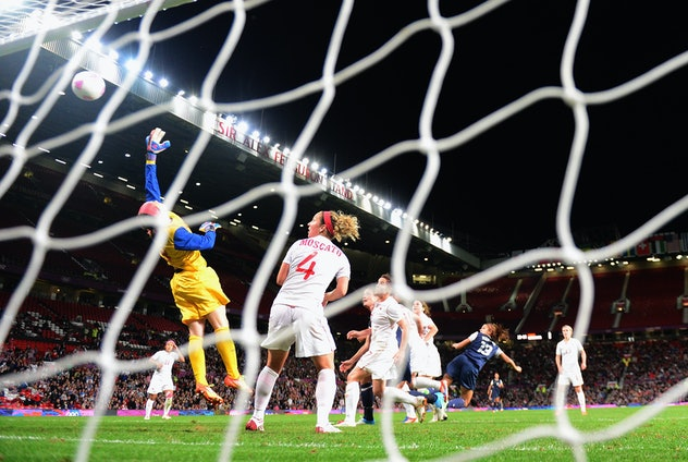 MANCHESTER, ENGLAND - AUGUST 06:  Alex Morgan of USA scores the winning goal during the Women's Foot...