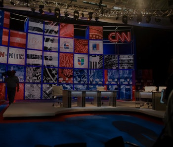 A camera man walks through the set, during the preview of the CNN set where Democratic candidates Ba...