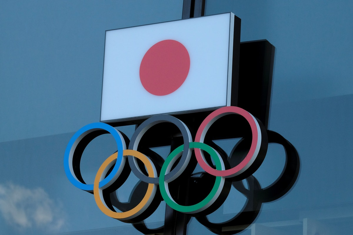 This picture shows the logo of the Japanese Olympic Committee displayed at an entrance of the Japan Olympic Museum in Tokyo on March 24, 2020. - The International Olympic Committee came under pressure to speed up its decision about postponing the Tokyo Games on March 24 as athletes criticised the four-week deadline and the United States joined calls to delay the competition. (Photo by Kazuhiro NOGI / AFP) (Photo by KAZUHIRO NOGI/AFP via Getty Images)