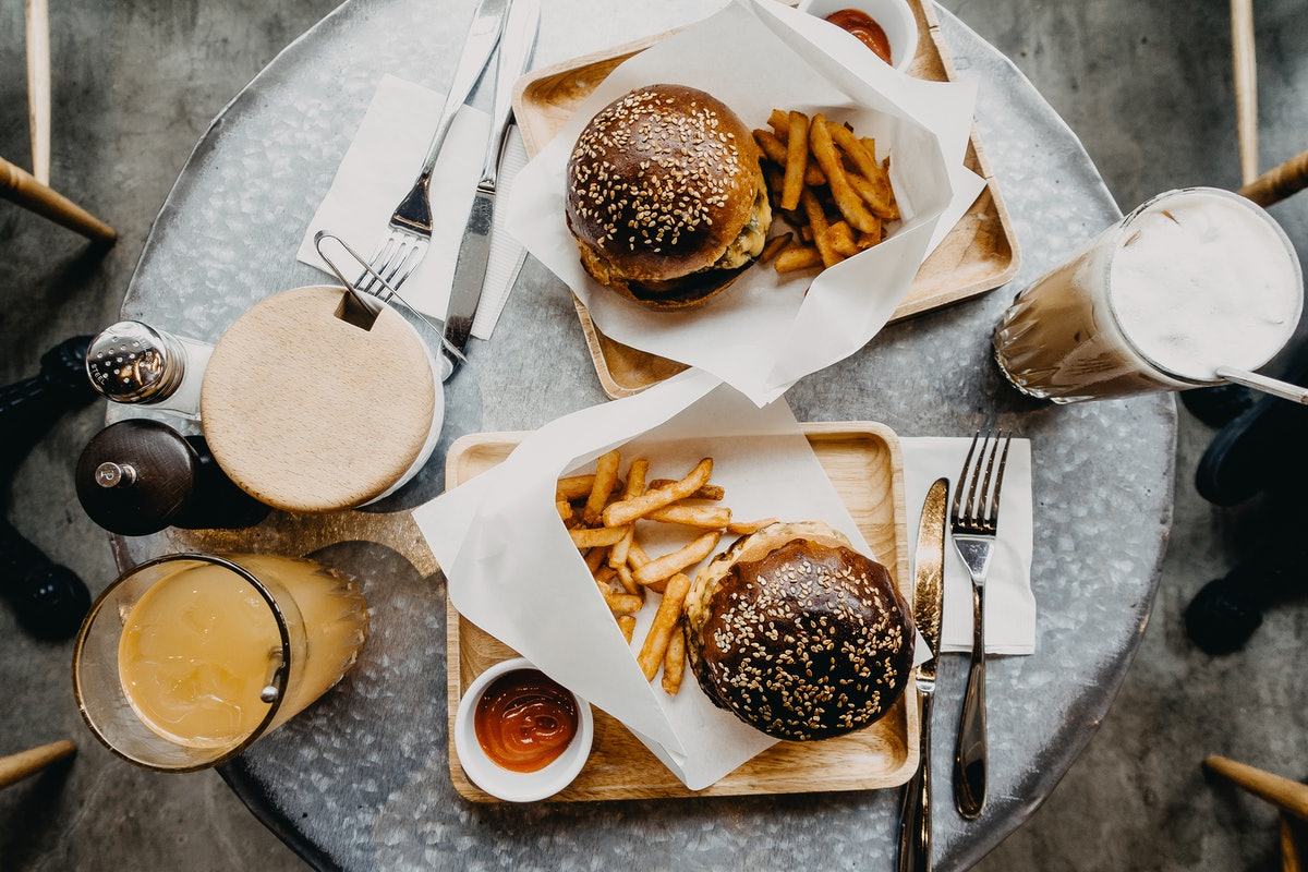 Burgers and fries are great takeout food for a cozy night in with your significant other.