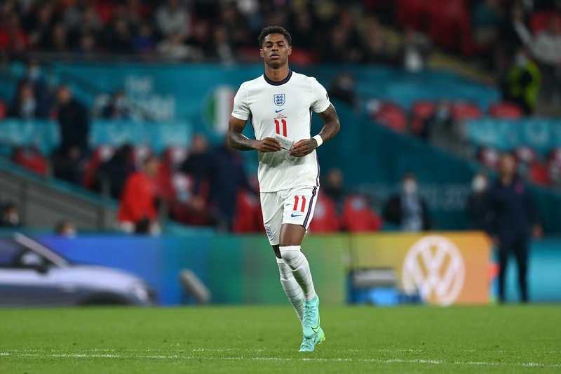 LONDON, ENGLAND - JULY 11: Marcus Rashford of England reacts after missing their team's third penalt...