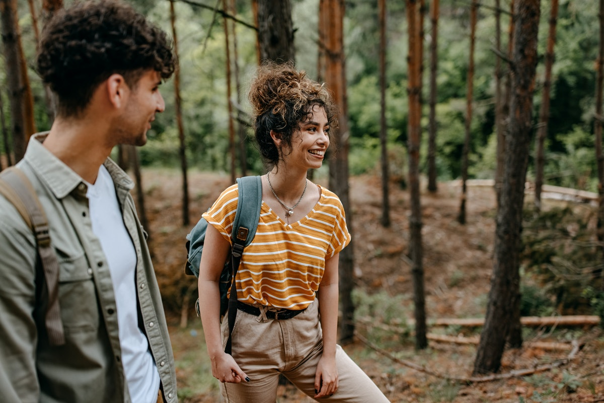 Two exes hiking as friends.