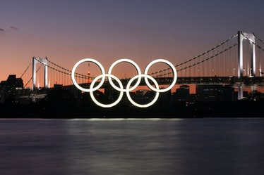 TOKYO, JAPAN - JULY 17, 2021: Olympic rings are pictured with the Rainbow Bridge in the background. ...