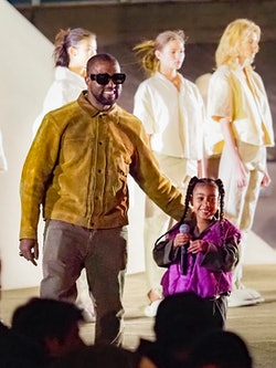 """PARIS, FRANCE - MARCH 02: Kanye West and daughter North West attends the """"Yeezy Season 8"""" show as part of the Paris Fashion Week Womenswear Fall/Winter 2020/2021 on March 02, 2020 in Paris, France. (Photo by Arnold Jerocki/GC Images)"""
