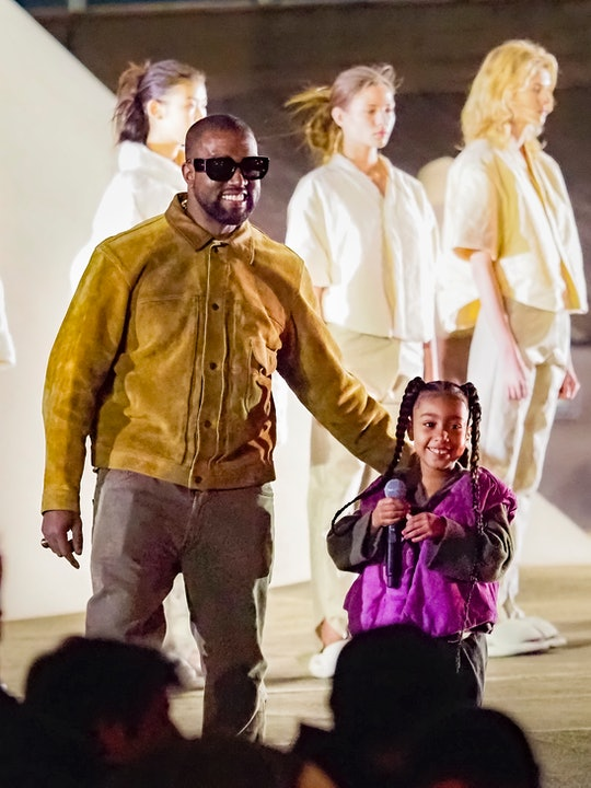 """PARIS, FRANCE - MARCH 02: Kanye West and daughter North West attends the """"Yeezy Season 8"""" show as pa..."""