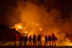 MOUNTAIN HOME VILLAGE, CALIFORNIA - September 9: A group of inmate firefighter watch as the El Dorad...