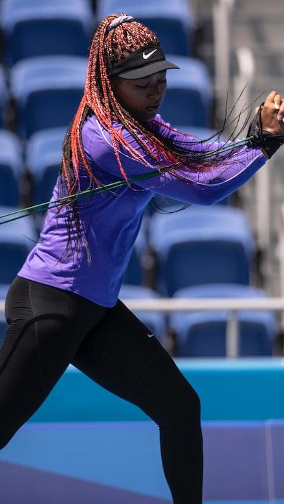 TOKYO, JAPAN - JULY 20: Naomi Osaka of Team Japan trains in Center Court Ariake Tennis Park ahead of...