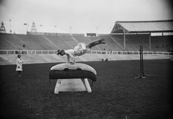 July 1908:  A Danish gymnast performing on a gymnastic pommel horse at the 1908 London Olympics.  (P...