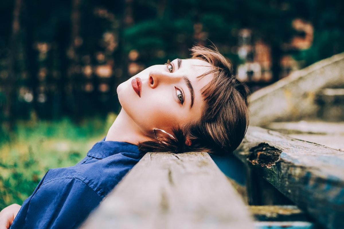 young woman reflecting on uranus in taurus retrograde 2021